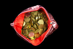 Money. Russian coins  in a red purse arranged on a black background Stock Image