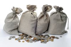 Money sacks and coins. On a white background royalty free stock images