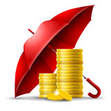 Money safety concept. Two stacks of golden coins under an red umbrella Stock Images