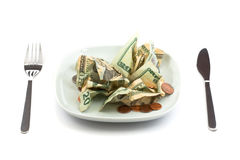 Money salad with dressing of coins Stock Images