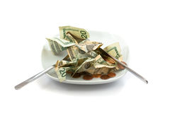 Money salad with dressing of coins Royalty Free Stock Photo