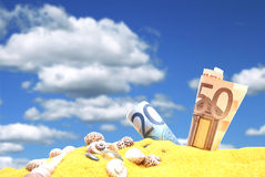 Money in sand Royalty Free Stock Images