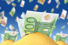 Money in sand Stock Image
