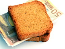 Money Sandwich. A 100 Euros sandwich - a metaphor for money hunger, desire, etc. Can also be used to refer to eating money to be successful Royalty Free Stock Photo