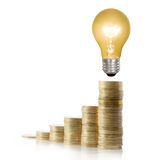 Money saved in different kinds of light bulbs Stock Photo