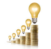 Money saved in different kinds of light bulbs Royalty Free Stock Photography