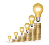 Money saved in different kinds of light bulbs Stock Photography