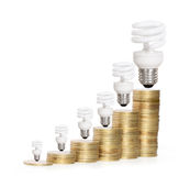 Money saved in different kinds of light bulbs Royalty Free Stock Photos