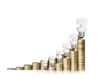Money saved in different kinds of light bulbs Stock Photos