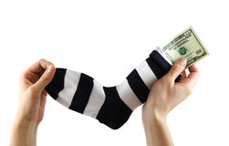 Money saving. Hiding money into a sock Stock Photography