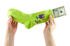 Money saving. Hiding money into a sock Stock Images