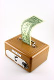 Dollar bill in cash box Royalty Free Stock Photos