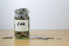 Money saving for car in the glass bottle Stock Image
