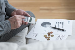 Money saving. Close-up of aged poor man saving his money Stock Image