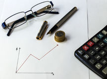 Money saving coins. Planing progress with graphs Royalty Free Stock Images