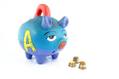Money saving in a colorful piggy bank. Isolated on white background Stock Images