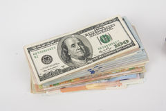 Money saving concept. Earn money or save money concept, different banknote isolated on white Royalty Free Stock Image