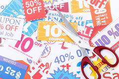 Money saving coupon vouchers with scissors. Money saving coupon vouchers with the scissors Royalty Free Stock Photos