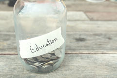 Money saving for education in glass with vintage filter Royalty Free Stock Images