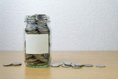 Money saving in the glass bottle Stock Images