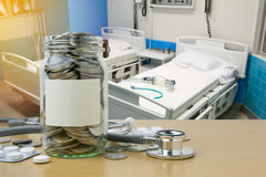 Money saving for Health expenses in the glass bottle. Closeup stock photos