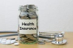 Money saving for health Insurance in the glass bottle stock images