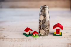 Money saving for house in the glass bottle Stock Photography