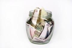 Money saving in jar Royalty Free Stock Images