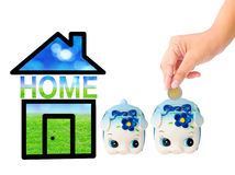 Money Saving with Piggy bank and home icon. Royalty Free Stock Image