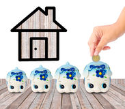 Money Saving with Piggy bank and home icon. Royalty Free Stock Photo