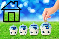 Money Saving with  Piggy bank and home icon. Royalty Free Stock Photography