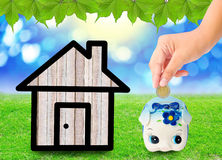 Money Saving with  Piggy bank and home icon. Royalty Free Stock Images