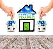 Money Saving with  Piggy bank and home icon. Saving money for home concept Royalty Free Stock Photos