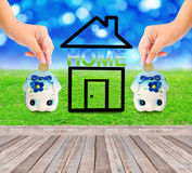 Money Saving with  Piggy bank and home icon Stock Images