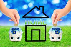 Money Saving with  Piggy bank and home icon. Stock Photography
