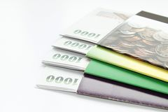 Money and savings account passbook on white background. Concept of savings : Money and savings account passbook on white background Stock Image