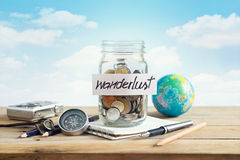 Money savings in a glass jar on blue sky background Royalty Free Stock Photos