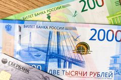 Money and sberbank credit card on a woody background royalty free stock image