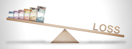 Money scale Stock Images
