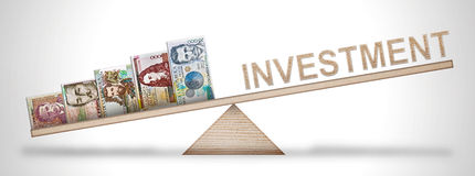 Money scale. A scale holding money and symbolizing economic relationships Stock Photo