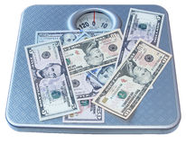 Money on scales Stock Images