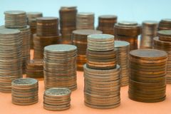 Money scape. A cityscape  of piled up coins Royalty Free Stock Photos