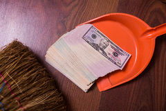 Money in the scoop, shovel, broom and money. Business plan, money background, hundred dollar bills front side. background of dollars, revenge money, earn a lot Stock Photos