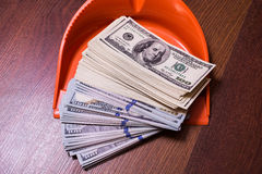 Money in the scoop, shovel, broom and money, business plan. Money background, hundred dollar bills front side. background of dollars, revenge money, earn a lot Royalty Free Stock Photo