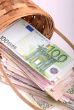 Money set in a basket, dollars, euro and ukrainian money Stock Photography