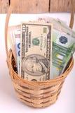 Money set in a basket, dollars, euro and ukrainian money Stock Photo