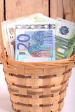 Money set in a basket, dollars, euro and ukrainian money Stock Images