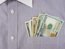 Money in shirt pocket Stock Image