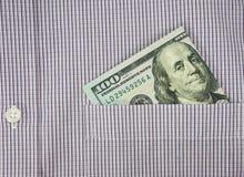 Money in shirt pocket Royalty Free Stock Photo