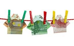 Money shirts laundering on clothesline Stock Photography